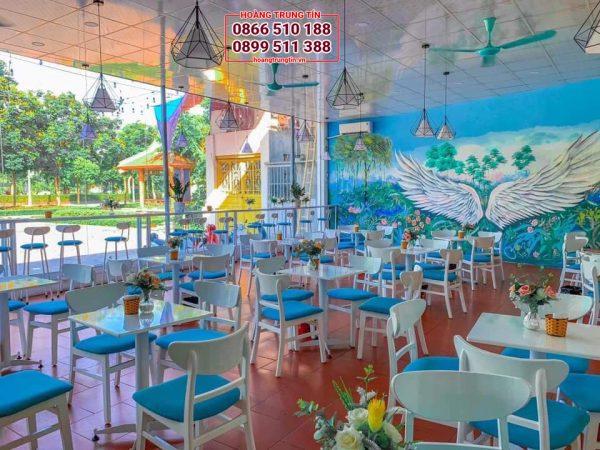 bàn ghế quán trà sữa bằng gỗ mẫu ghế mango sơn trắng nệm xanh